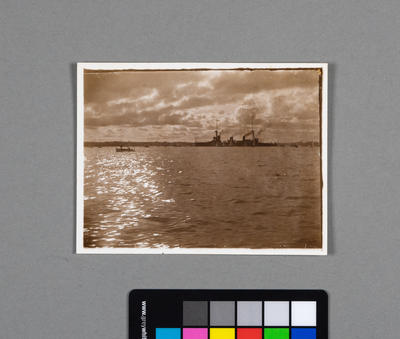 [Photograph of coal ship on water]
