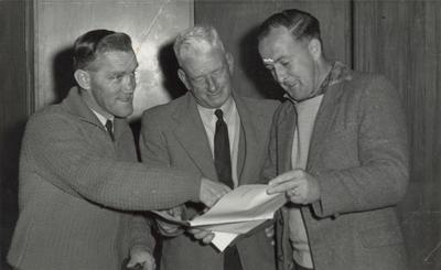 [Three unidentified men]