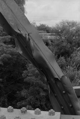 Photograph of damaged rail bridge