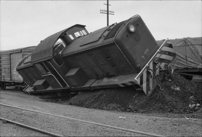 Photograph of locomotive DSC 406 tipped over