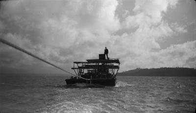 Photograph of barge under tow
