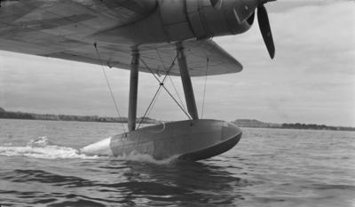 Photograph of seaplane under tow
