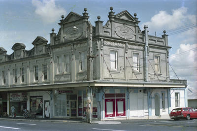 Photograph of shops and flats, Kingsland