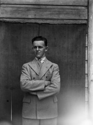 Man wearing ANZAC Task Force lapel badge