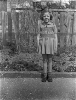 Girl standing on garden path