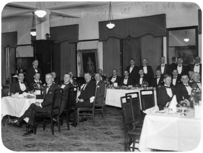Men seated at event