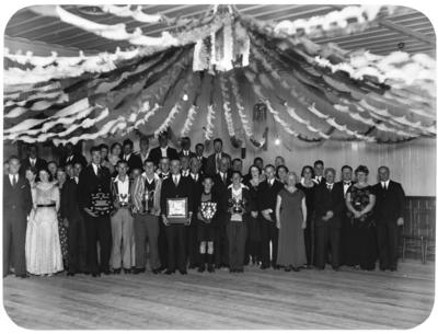 Group portrait of football club prize giving