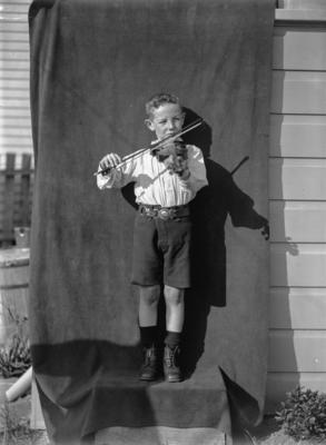 Boy Scout playing a fiddle