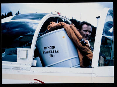 """[Cliff Tait and his petrol tank seated in Airtourer ZK-CXU """"Miss Jacy""""]"""