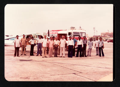 [Cliff Tait with crowd at an airport in India]