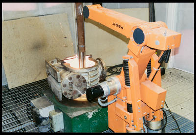 [Photograph of ASEA robotic arm in action]