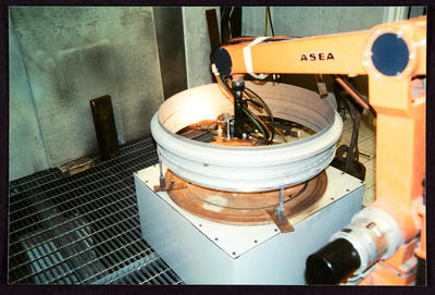 [Photograph of ASEA robotic arm in action]; Aerospace Thermal Coatings; 1992-2012