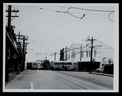 [Tram 243 and trolley bus 8, including 282, outside Dominion Road shops]