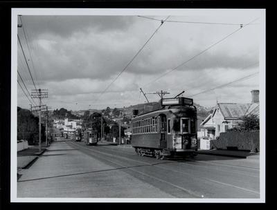 [Tram 218 with trams on track behind]