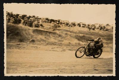 [Charlie Buchanan during motorcycle race]