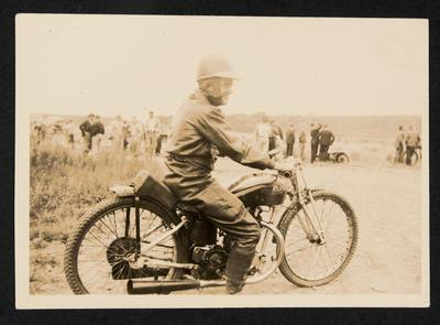 [Charlie Buchanan seated on a motorcycle]