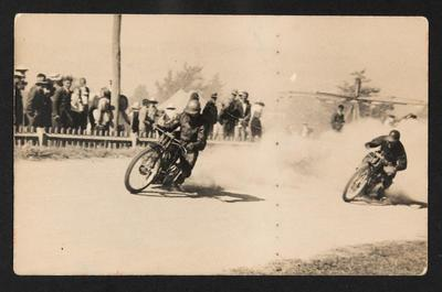 [Motorcyclists racing on dirt track]