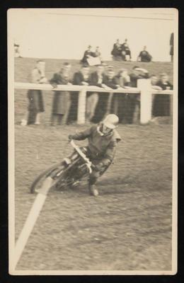 [Motorcyclist racing on dirt track]