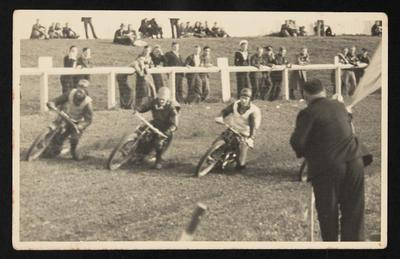 [Motorcyclists racing on a dirt track]