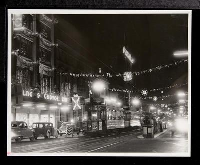 [Tram 217 on Queen Street in front of Milne and Choyce at night]