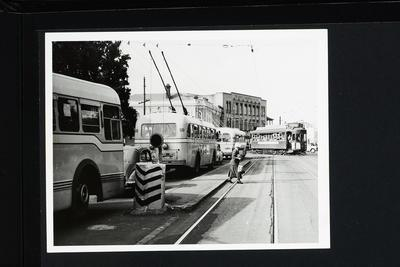 [Row of trolley buses and tram on Symonds Street]