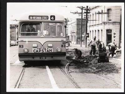 [Trolley bus 83 on Zoo - Westmere route next to tram track removal]
