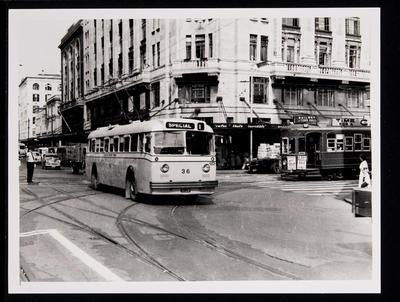[Trolley bus 36 and tram 243 crossing Queen Street and Custom Street]