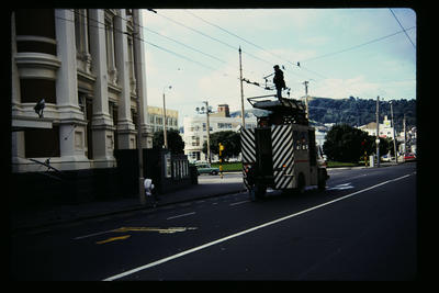 Repairing  trolley wires outside Town Hall, Wakefield St.; Peter Moses; 1978