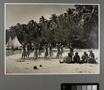 [Tahitian performers on beach]