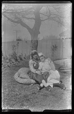 [Glass plate negative unknown woman seated on grass]