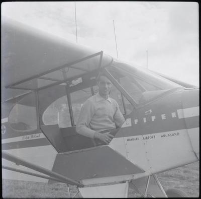 [Unidentified man in cockpit]