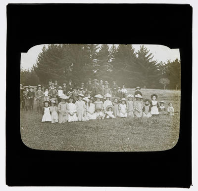 [Group of children in a field]