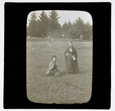 [Two unidentified women in a field]
