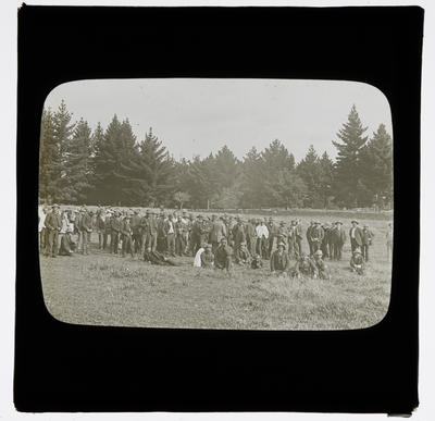 [Large group of men in field]