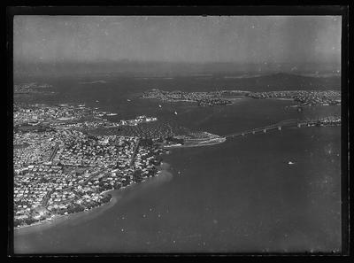 [Black and white glass plate negative aerial photograph of Auckland Harbour and Harbour Bridge]