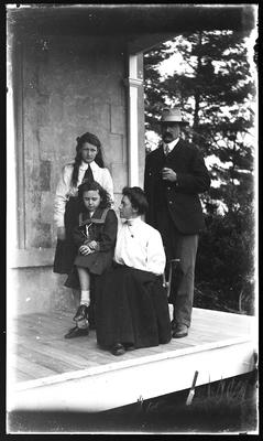 [Black and white glass plate negative of family group portrait]