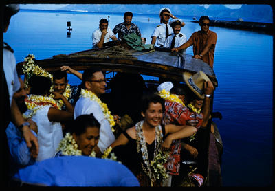 [TEAL Short Solent Coral Route crew and passengers in launch with lei departing from Tahiti]