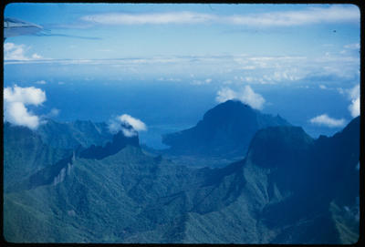[Aerial view of island mountain landscape]