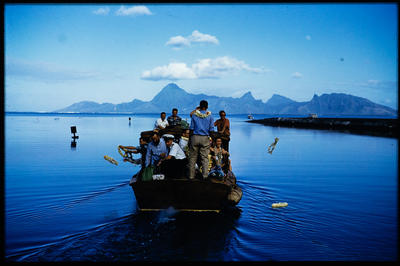 [TEAL Short Solent Coral Route passengers in launch departing from Tahiti]; Hajo Topzand; 1950s