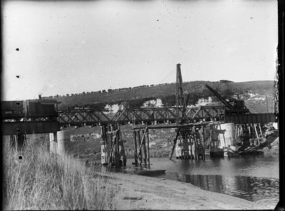[Wide scale image of bridge construction  over a river]