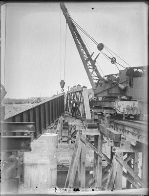 [Bridge construction with crane]