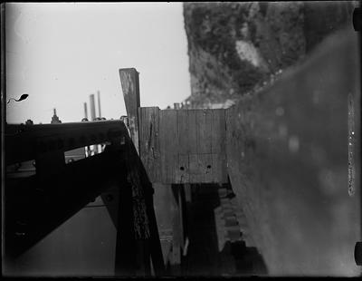 [Close up of materials used in bridge construction over a river]