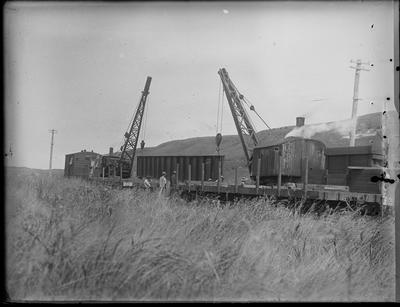 [Cranes in process of bridge construction]