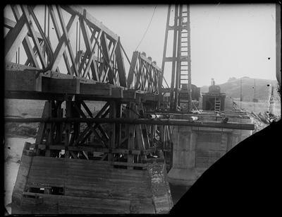 [Bridge construction over a river]
