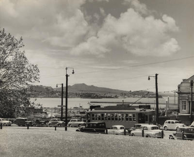 [Tram on Anzac Avenue showing a view of the Waitemata Harbour]