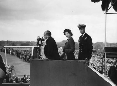 Photograph of Princess Elizabeth and Prince Philip on a podium at the  launching  ZK-AML
