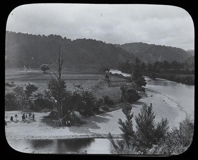 [Unidentified people on river bank]