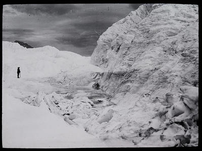 [Mountain climber in snow on mountain]