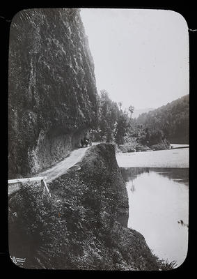 [Road cut out in cliff]