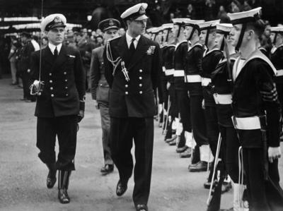 Photograph of Prince Philip inspecting a parade of navy cadets